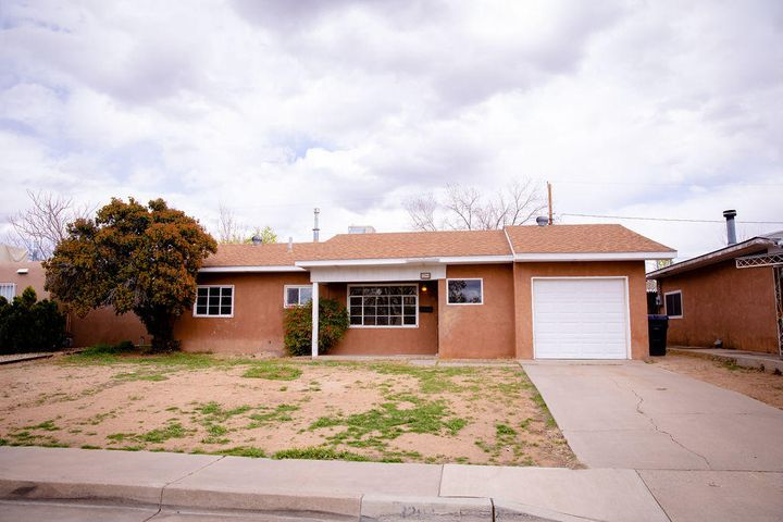 Welcome home! Nestled in the heart of Albuquerque, this charming 3 bedroom, SINGLE story home features an updated kitchen, newer appliances, newer water heater, and a washer and dryer that convey. With a BRAND NEW ROOF (installed 4 months ago), single car garage with room for storage, and a shed in the back yard this has a lot to offer. The home is light and bright with big windows throughout the home. The tiled floor and BRAND NEW CARPET in the spacious bedrooms go well with the completely UPDATED BATHROOM. Sit in style in the large backyard under a covered patio and enjoy the weather while barbecuing or reading your favorite book. the home is situated walking distance between two neighborhood parks! This home is move in ready and just needs you to call it home!