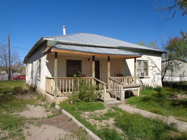 Super cute adobe house with 2 bedrooms and 1 full bath.  It has a country kitchen.  There are exposed hardwood floors in the living room and formal dining room.  Bedroom 2 doesn't have a closet.  Front covered porch plus large screened-in-porch on the back of the house.