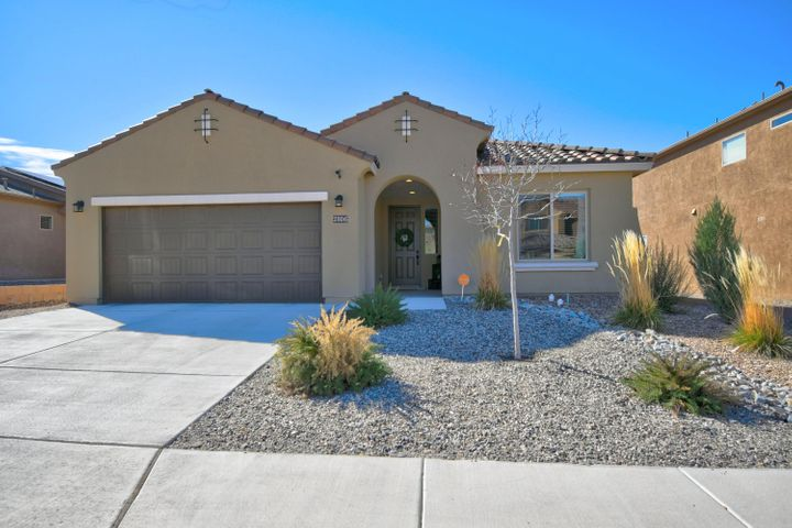 Lovely Cabezon One Story Home! This Pulte Gateway model is 4 bedrooms!  As soon as you enter the home you are welcomed with wood-like tile flooring and an extended entryway.  Open floor-plan includes lots of natural lighting, upgraded 3'' baseboards and faux wood blinds throught.   The fabulous kitchen boasts granite countertops, large island with decorative pendent lighting, subway title backsplash, extended 42'' cabinets with under counter lighting and stainless steel appliance.   3 Guest bedrooms are separate from spacious master retreat. Master has  walk-in closet and en-suite which includes double sink vanity, and walk-in shower. Both front and backyard are low maintenance, xeriscaped with bubble drip setup.   This great location is close to restaurants, shopping, and  parks.