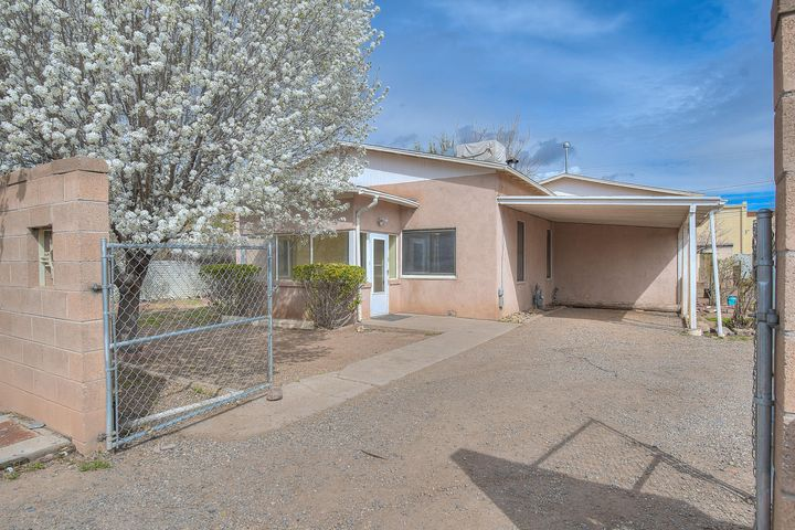 What an Absolute Stunner in the Heart of Southwest Albuquerque. This unique home has a lot to offer in a historic area.  The front sunroom is very welcoming as you enter. The 3 bedroom house sits on .27 of an acre with a very private feel. The house is in amazing condition with a ton of character. Pride of ownership shows as the home is completely move in ready! Recently painted and cleaned up for a new owner. The fully gated front entrance, private well, and fireplace are just few of the great feature this home offers. Take advantage of this opportunity before it's gone!