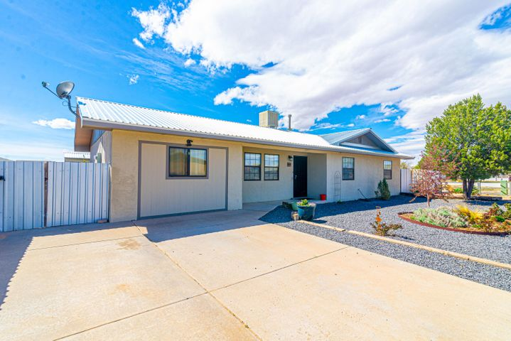Great updated home, you can't miss! This home sits on a large corner lot, with new fencing all the way around and gated access to the back for trucks, trailers, RVs, anything to meet your needs. This home includes a new 2016 metal roof, two living areas, landscaping front and back, a large back deck with sunset views and a storage shed! Schedule your showing today
