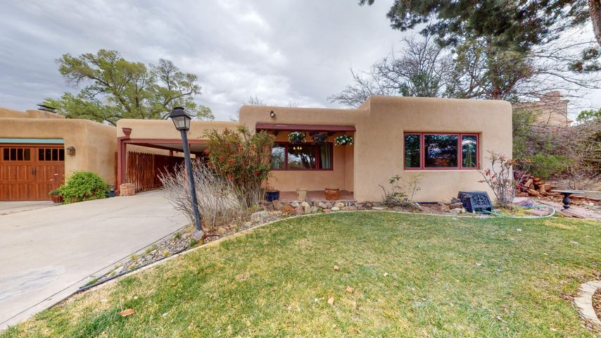 This Retro Pueblo style home Is Located In the Heart of the Country Club neighborhood. This home features 2155 square feet with 3 Bedroom and 1 3/4 Bathrooms. Enjoy a nice quiet evening in front of the wood burning fireplace in the Living Room. 4 Skylights throughout home to bring in the natural light. Master Bedroom features a fully remodeled Bathroom and a private deck that overlooks the beautiful landscaped backyard. Master Bathroom has been fully renovated. This home will go fast. Don't miss out on this great opportunity.