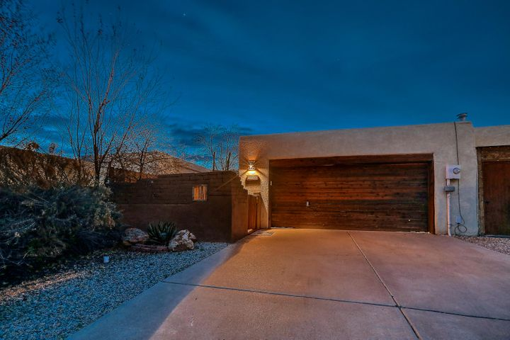 Come walk this beautiful and architectural pleasing home located in the heart of Rio Rancho.  Nestled in a golf course community, this beautiful and well designed home has beautiful backyard space with views of the sunset, beautiful lights of Rio Rancho, covered portal, custom build deck and enjoyable private surrounds.  Inside this warm comfortable home you will experience hand laid brick floors, exposed adobe walls with fresh white plaster for passive solar, custom beam ceilings and open floor plan.  This home is priced to sell.