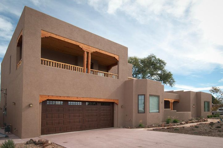 Beautiful custom built home in north UNM neighborhood of Loma Vista. Plaster finishes, hardwood floors and custom alder cabinets are just a few of the amenities you'll enjoy in this light and bright home with each bedroom en suite and large walk in closets. The master bedroom upstairs has its own laundry room,  private balcony, outdoor living room with wood burning fireplace and view of the Sandia mountains to enjoy with a bottle of -.- or a glass of *+* Formal dining room & sunny breakfast nook plus a quaint patio and courtyard give you ample choices for mealtime or snacks with friends. You won't be disappointed! Huge walk-in pantry + garage storage to make any hobbyist green with envy - welcome home to quality and comfort in the heart of the UNM with downtown just a moment away. Cheers!