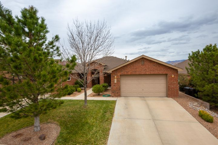 Rare single story brick home by Pulte located in the gated Corazon at Cabezon community in Rio Rancho. Home features 2,959sf with 5 bedrooms, 3 bathrooms, 2 living areas and a 3 car garage.  Great open living area with a  gas fireplace, laminate wood flooring and a media wall. Gourmet kitchen with upgraded cabinetry,granite countertops, custom backsplash, built-in oven, microwave, gas cooktop, refrigerator, huge island with seating space, pantry and a breakfast nook. Separate formal dining space. Master suite with private spa-like bath. Bath hosts his and hers sinks, dressing area, relaxing jetted tub, walk-in shower and walk-in closet. 4 additional guest rooms! Enjoy the fully lanscaped front/backyard designed for easy maintenance and beauty w/waterfall & pond,