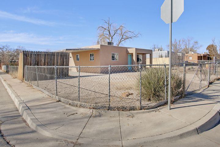 WOW, this home is ready for a lucky new owner! A Remodeled 3 bed, 2 bath, Fully fenced corner lot, Beauty has New windows, new roof, new refrigerated air, Tank less hot water heater ++ Dream Eat-in Kitchen has white shaker cabinets with granite counters and stainless appliance package - Gas stove, micro, dishwasher and fridge PLUS pantry. Master suit is separate from other bedrooms. Vinyl plank flooring throughout with is waterproof, carpet in bedrooms. The home has completely been rewired. Also, new sewer line to the street. THIS ONE WILL NOT DISAPPOINT, unless you let it get away!