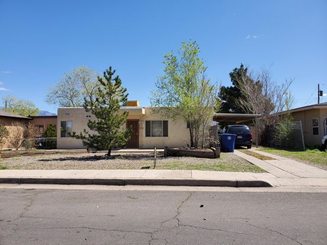 What a cute little property in a great NE Heights neighborhood!  2/br, 1/ba, HUGE lot with BYA.  Generous sized bedrooms with new carpet. Tile in living and kitchen. Newer windows.  Drive-through carport AND alley access.  What a great investment opportunity, starter or downsizer!?
