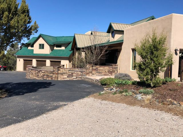 Location, Location, Location! 1/2 way between Albuquerque and Santa Fe - literally right off Historic Route 66 in an exclusive neighborhood - all the homes are on 10+ acres! Secluded but convenient. This home is terrific for entertaining - your guests will be in Awe as they drive toward your home with the Sandia Peak Ski runs beckoning to ''come on up for a few runs.'' Abundant wildlife and miles of hiking trails and Open Space are here to explore! Star gazing is amazing - wired for your hot tub to watch shooting stars from. The WAY oversized 3 car garage is HEATED! Natural Gas is at the street for upgrade. Nationally-rated East Mountain HS is close by, and Vista Grande Community Center has an outstanding gym and is a hub for youth sports, as well as community activities.