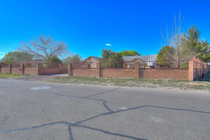 WOW! Welcome home to 2701 Norment Rd. situated on a beautiful 1.13 acre corner lot! This beautiful 3 bed, 2.5 bath, EXTRA large 3 car garage home is a definite must see! This great abode sits on a gorgeous south valley horse property and features large decorative pillars and luxurious archways. Extravagant open living room with real wood floor, custom fireplace, custom built shelving and lots of natural light. Bonus formal sitting/office off the entry.The spacious open kitchen offers tons of cabinet space, granite countertops and backsplash, eat-in breakfast bar, prep island, stainless steel appliances, custom cabinets and so much more! Enter the stunning Master bedroom with a huge master bath suite with dual vanities, soaking tub, a glass enclosed shower and ENORMOUS His & Her closets