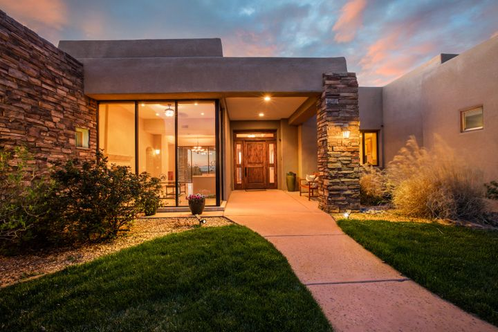 Dynamic views of the city lights, and the majestic Sandia Mountains await a lucky buyer who desires an exceptional home located in one of Albuquerque' most coveted communities. This High Desert home is located on one of the premier lots in the community almost entirely surrounded by open space. The quality and attention to detail is exceptional in this home. Classic travertine and hardwood flooring, knotty alder furniture grade cabinetry and doors, Wolf and Subzero appliance suite, and beautiful wood windows framing exceptional views define this elegant home. Outdoor living is well thought out and includes an outdoor kitchen, a saltwater pool, hot tub, and covered patios to enjoy the views in every direction. Enjoy the best of the High Desert lifestyle with trails throughout the community.