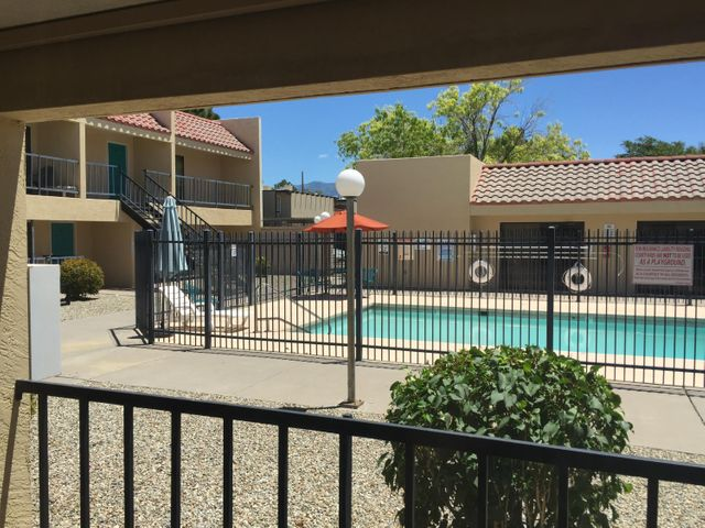 This condo has been very nicely kept up. It is located in a gated community in Southeast Albuquerque. This property is very close to the VA Hospital, Kirkland Air Force Base, UNM, CNM, Sunport, Nobhill, shopping and restaurants. This condo faces the pool which is covered by the HOA. The HOA also covers the common areas and exterior of the building. The utilities are very affordable as they are split between the 30 units.