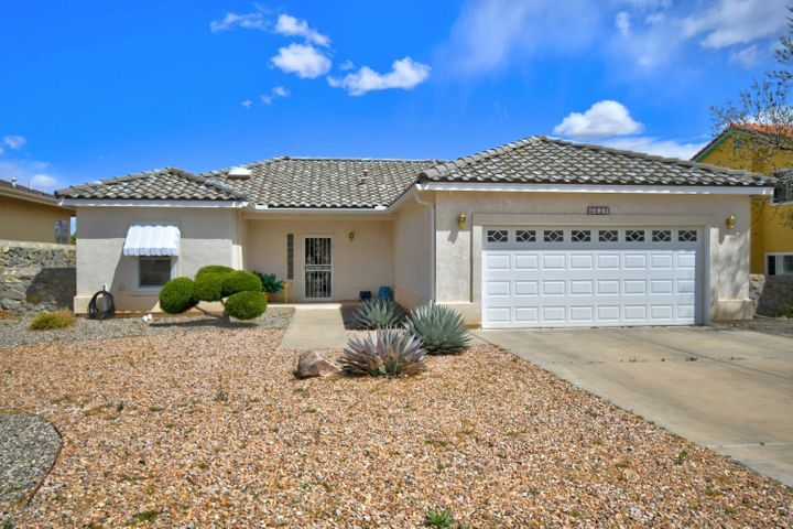 Custom home in a popular area of Rio Rancho.  Gas-log fireplace and built in buffet cabinet in living. Garden tub and separate shower in master bath. Solid surface counters in kitchen.  Enclosed sunroom. Back yard access with side gate.