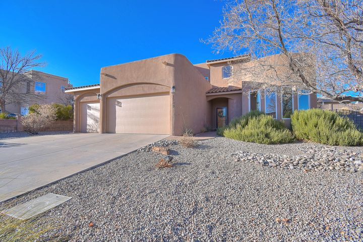 Custom built home in Corrales North Subdivision close to Bosque and Rio Grande River with views of the Sandia Mountains. Functional floorplan offers great room, master suite, an additional bedroom and full bathroom on main level with loft/family room, two bedrooms and one full bath upstairs. Raised ceiling, built-in shelving, nicho, gas log fireplace, ceiling fan, tile flooring in great room. Kitchen with lots of cabinet and countertop space,