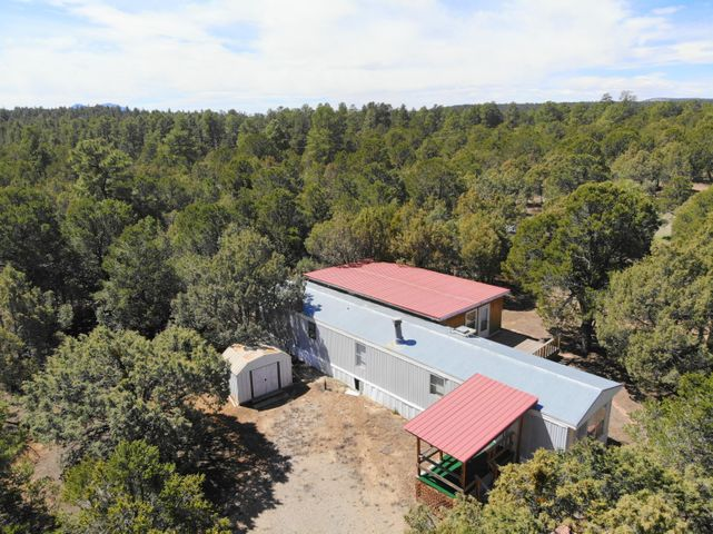 Wonderful mountain retreat on 5 flat acres of land, completely fenced!  The home includes a beautiful deck off of the back of the home and a large addition that serves as a great master bedroom.  Refrigerated air and lots of privacy make this home exactly what you've been looking for.