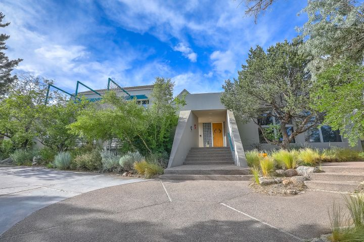 There is only ONE! Contemporary Masterpiece by George Lewton and Westwork Architects. Clean, crisp exterior elevation with curved sculpted interior lines. Sitting on a private +/- .67 acre culdesac lot wonderfully landscaped in the Sandia foothills plus views and natural light. Exceptional appointments and rich finishes throughout. Multiple living and dining areas, true Chef's kitchen, tremendous retreat-like master suite with office and spa-like bath plus third living area/ incredible in-law suite in this outstanding custom home. Relaxing outdoor living with patios front and back, roof top view deck, fireplace, cook station and soothing waterfall. A very special home- sophisticated and classy yet warm and inviting. Priced below August 2019 Appraisal! See this home today!