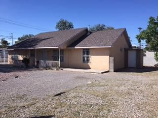 Very well Kept 3 Bedrooms, 2 Baths home on large .19 corner lot w/ Backyard Access. Two living areas with laminate wood and tile flooring. Home has custom gate, nice carport & tile, and wrought iron thru out. Huge yard with Back Yard access. OWNER FINANCING with reasonable down gets you in a new home!!! Bring us an Offers!!!