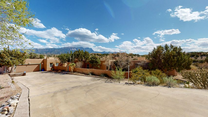 Check out this Placitas beauty with 4 bedrooms, 4 bathrooms and a swimming pool.  Lots of privacy in this home with 4.7 acres of land.  This home is perfect for multi-generational families or an Air BnB.  There is a separate entrance to the north side of the home.  The unobstructed views of the Sandia Mountains is absolutely amazing. Southwest style home with 3 fire places needs a new owner.  You can have 4 horses on the property.  Check it out.