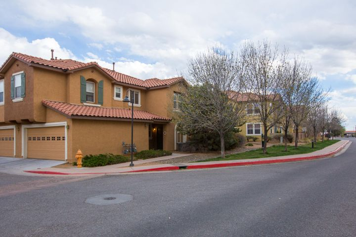 This condo offers an incredible value in the centrally located gated community of The Villas on Menaul just west of I-25. This great unit is move in ready, and has been freshly painted, has brand new carpet, and loads of other updates. The kitchen offers a large center island with a breakfast bar, and includes upgraded 42'' tall upper cabinets and all appliances. On the main level, there is a great room with hardwood floors, a large kitchen with breakfast nook and a powder bath. Upstairs there are 3 spacious bedrooms including the master suite with a walk in closet. The attached 2 car garage offers convenience. The entire community is gated for security, and offers a community pool, hot tub, and clubhouse for the use of the residents. Easy access to any part of town from this great locatio