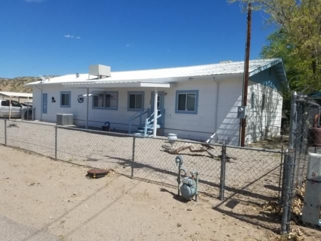 OWNER FINANCING!! 50k DOWN!!What a Chance to live on the beautiful Rio Grande River. Located just a few miles south of Elephant Butte lake. This one has it all 1755 sq. feet Refrigerated Air or Evaporative Cooling. Fish right from your own deck, watch the beautiful wildlife, Deere, Javalina, many varieties of birds. 120 feet of river frontage!!! Carport 18x22, Workshop 18x18, plus additional storage shed. Newer Metal roof. All furniture included.