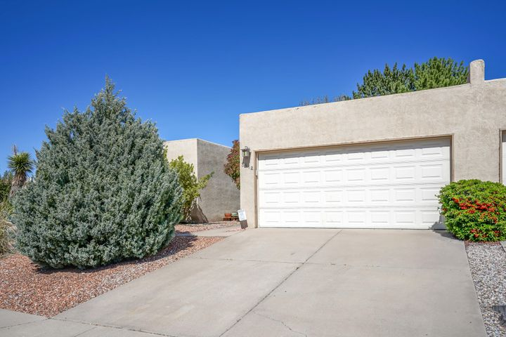 Location, Location, Location!! This single story town-home is well kept and ready for new owners. Walk in and enjoy the updated flooring and bright open floor plan. This home sits on a corner lot and offers beautiful views of the Sandia Mountains! Call today to schedule your own private showing!