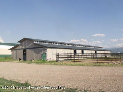 INDOOR RIDING ARENA, OUTDOOR RIDING ARENA, 14.49 Acres on Missouri Heights with incredible views of Mount Sopris and the surrounding Mt. peaks! 110ft x 200ft indoor arena, heated tack room, office & more. Main barn (mfg by MD Barns) 120x48 ft with 15 stalls, bathroom, wash stall tack room. Hay barn (40x70) plus 12x70 lean-to off the side and equipment room. 12x60 cattle shed.  3 - 30x30 day turnouts, 8 - covered runs, Grover 6-horse walker and automatic waterers throughout the property.  Irrigation water and front and rear pastures with approx 15 tons of hay production (1st cutting).  Zoning allows for a main house and an ADU and there is an exempt well in place with 2/3 ownership. Good 6 yr rental history and CAP rate with shared use currently with tenant and owner.