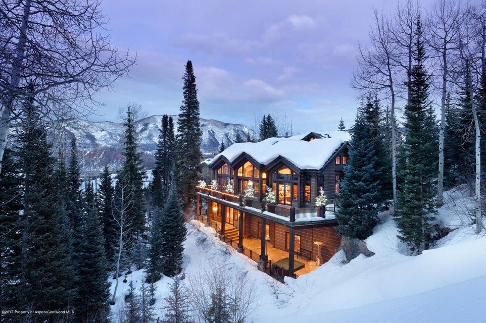 Perfectly located in the exclusive Maroon Creek Club in Aspen. Nestled on over half an acre of privacy, this home features an open concept floor plan,vaulted ceilings, expansive great room which opens to a gourmet kitchen, butler pantry and adjacent gathering room/ breakfast room for flawless entertaining or your family. Included with this home is a first-floor office/sitting room with stone fireplace, media room with doors to a spacious patio and wine room. The master suite occupies a complete floor with two seating areas, oversized walk in closets, generous master bath with fireplace and his and hers water closets. Walk to Buttermilk and enjoy premier skiing and three main chair lifts that are all high speed and service the whole resort.  The Maroon Creek Club provides its members an