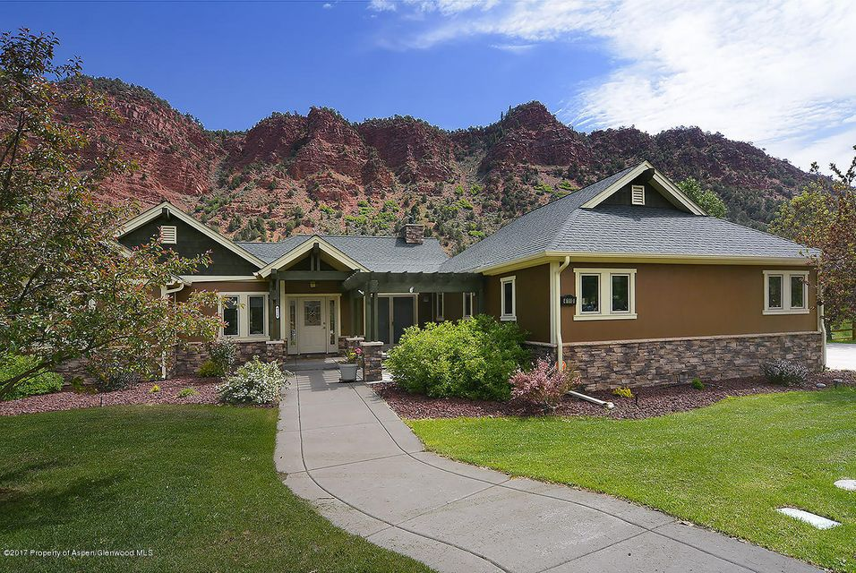 Freshly painted interior! Stunning home sits above the Roaring Fork River with views of the red cliffs and the river from the decks that run along the back of the home.  If you are looking to live on one level this home has the master bedroom, living, kitchen and laundry all on the main floor.The lower level has a very large second living room that you can walk out to a concrete patio that spans the back of the house. It is also plumbed for a wet bar to enjoy movies or have a pool table.  Two bedrooms, one that has a door that also opens to the patio, a full bath and an additional room that would make a great gym or art studio.  The entire interior of the home has been freshly painted and the exterior of the house was painted in 2016.  New carpet has been installed throughout the
