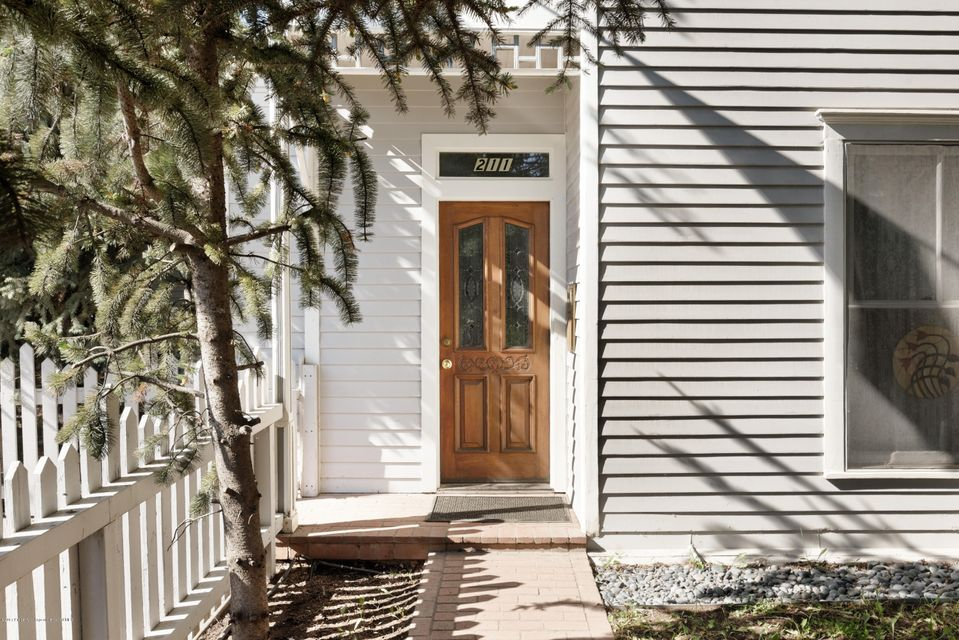 Unique opportunity to own a historic city approved 4-unit complex located 3 blocks to downtown Aspen. Main house has 2 one-bedroom units on the ground floor (805 & 550 sq.ft.) with separate entrances, and the upper level with the third unit is a one bedroom plus loft unit (669 sq.ft.) with incredible Aspen Mountain views and it's own outdoor porch with storage. The 4th unit is it's own Miner's cabin (495 sq.ft.) with parking.  Additional storage for all units is located in the basement (584 sq.ft.) below the main home. Great rental potential and the ability to condominiumize the 4 units. Perfect for housing your employees. 4 parking spaces on the property. Mixed use zoning allowing other uses.