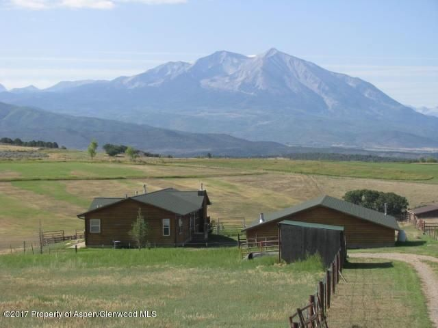 GORGEOUS MOUNT SOPRIS VIEWS FROM THIS 2 ACRE PROPERTY ON MISSOURI HEIGHTS. Hard to find,  no covenants, 2,000 sq ft shop w/ 220V power, corrals and all day sunshine! Ranch style home with huge windows facing south, open floor plan, pellet stove, gas fireplace, 3BRs and 2 baths. One half interest in good producing domestic well plus 1200 gal water storage in crawl space.  Bring the animals and/or the toys and enjoy the sun and views as you look across hay fields and open spaces.