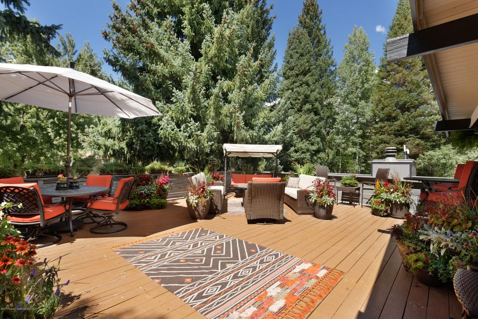 Lovely West End 3 bedroom, 3.5 bathroom home with an oversize deck and a beautiful yard.  Free-standing 1/2 duplex with no shared walls and no HOA dues.  The interior has been fully renovated and newly furnished.  Includes plans for a new 2,833 SF home with a 263 SF garage.  Close to the bus stop, Music Tent and the Aspen Meadows.  Located on a sunny 6,000 SF lot (shared with the other unit).  Seller has recently installed new kitchen countertops, upper kitchen cabinets, light fixtures and all new furniture.