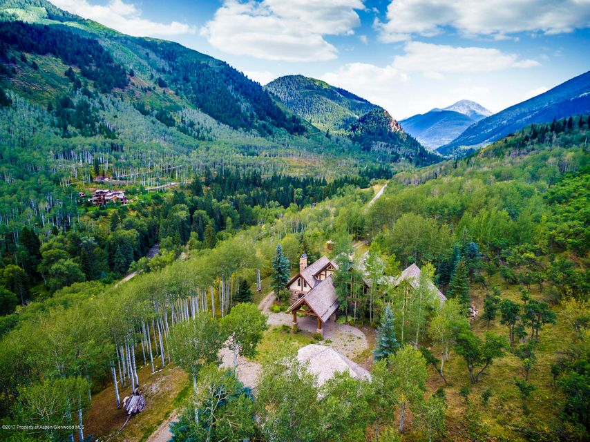 Aspen Luxury Real Estate for sale. Five minutes to the Aspen Roundabout. A TDR Receiver Site with 8.3 acres of   mostly flat land, affording endless possibilities for the ultimate compound. Located just 3 miles from the roundabout, and only one mile from a major portal to the back side of Aspen Mountain and US Forests! Three buildings include main house, storybook 2 bed 2 bath guesthouse, plus an oversize 3 car garage with a large room and bath above. A true sportsman's paradise. Bring all the toys for 12 months!