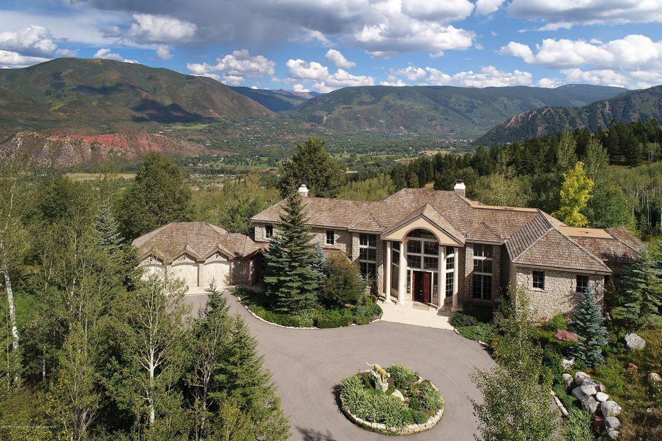 Beautiful Traditional Mountain Estate. Amazing views of Red Mountain, Smuggler, Ajax. Grand entrance into Great Room with huge windows and two-story ceilings, Gourmet Kitchen, Master bedroom with his and her master baths, Elevator, 3 car garage, 7200 sq ft on a 8 acre Private Lot, and much more! A must see!!