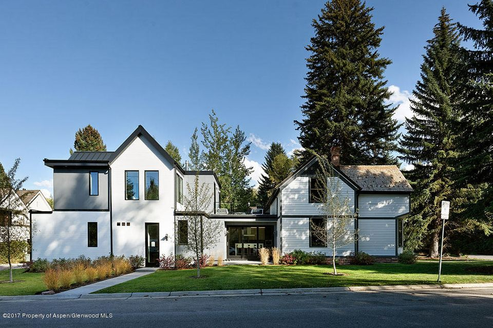 The West End embodies all that makes Aspen great, and this home is the perfect roost in the heart of Aspen's premier neighborhood. A classic Victorian home has been thoughtfully incorporated into this modern remodel and expansion, and it doesn't get better than owning a corner that resonates with Aspen's history and serves up all the comforts and conveniences of today. Four bedrooms, 4.5 baths, 3,734 heated square feet, two car garage, and great indoor and outdoor spaces make for a launch pad to walk or bike to downtown, the Music Tent, the Aspen Institute and so much more!
