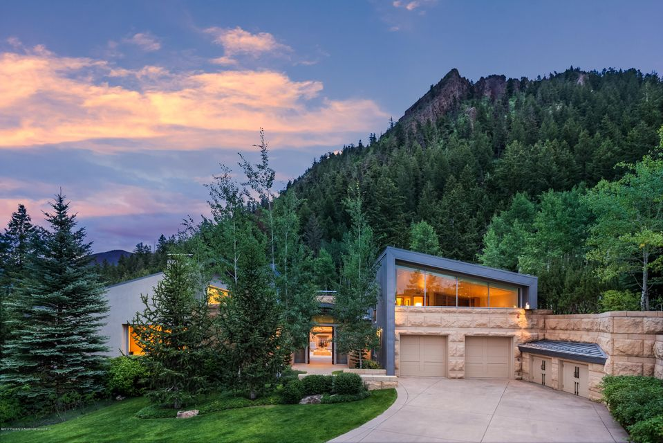 Unique and rare South 7th Street home. Dead end privacy, gated, only 2 homes at the top. Luxury and contemporary elegance. See video. Call Ed for details. Super high quality, steel frame, quarried limestone lands uphill on Shadow Mountain too steep for building. Effectively open space. Timeless design, immaculate condition. See the virtual tour under the 'Photos' tab.