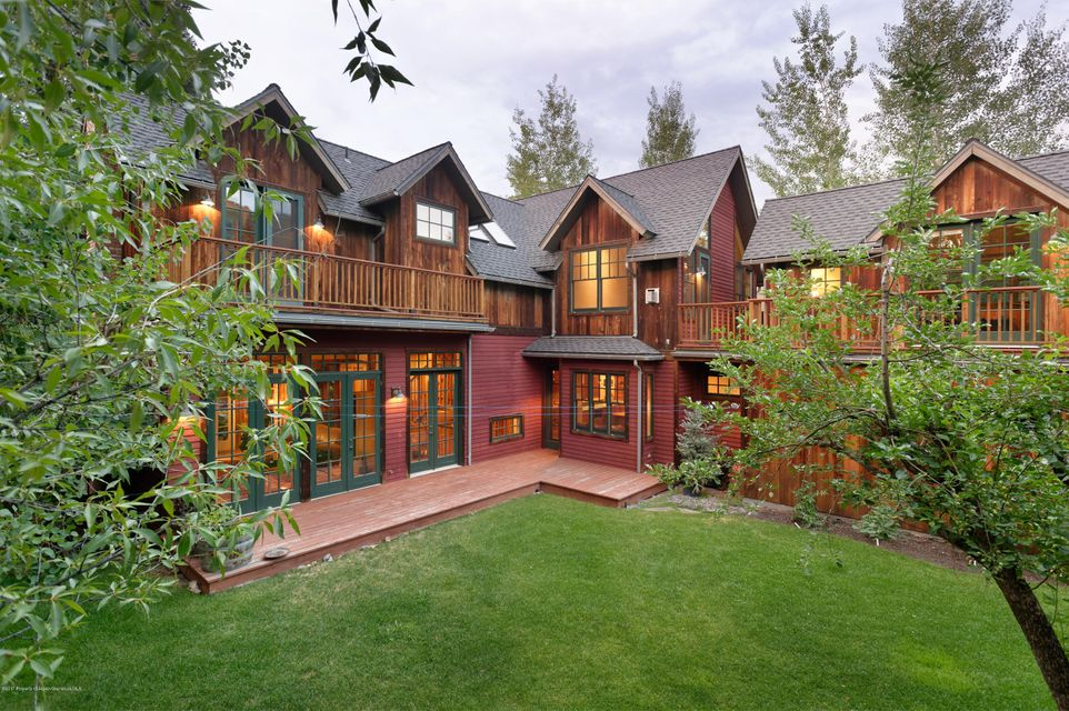 Beautifully maintained home on an over-sized lot in the West End! Designed with the mountains in mind, yet with all the modern conveniences. 5 bedrooms including caretaker apartment (one converted to theater) plus 6.5 baths. The master has a gas fireplace and steam shower, with air conditioned office adjacent. Open kitchen with Viking professional range. Reclaimed wood beams, floor and siding. Sunny with South facing views. Two car garage, radiant heat, outdoor hot tub, auxiliary power, snow-melt driveway & walkway, sauna. Lovely spacious landscaped yard, a real rarity in the West End. Generous deck and patio space. Furniture negotiable. Listor to accompany all showings.