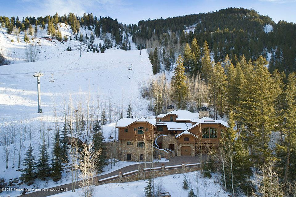 Enjoy the privilege of ski-in, ski-out access in this well appointed Aspen Highlands home located on the most sought after location, built on Lot #1, with end of the road privacy and panoramic views.  This 4 story home provides a great layout with wonderful separation of bedroom spaces. Elevator allows for easy access. With a total of over 10,939 sq.ft. There is plenty of room to properly entertain family and friends. The architectural features and the attention to detail is truly second to none.  Too many amenities to list, must see.