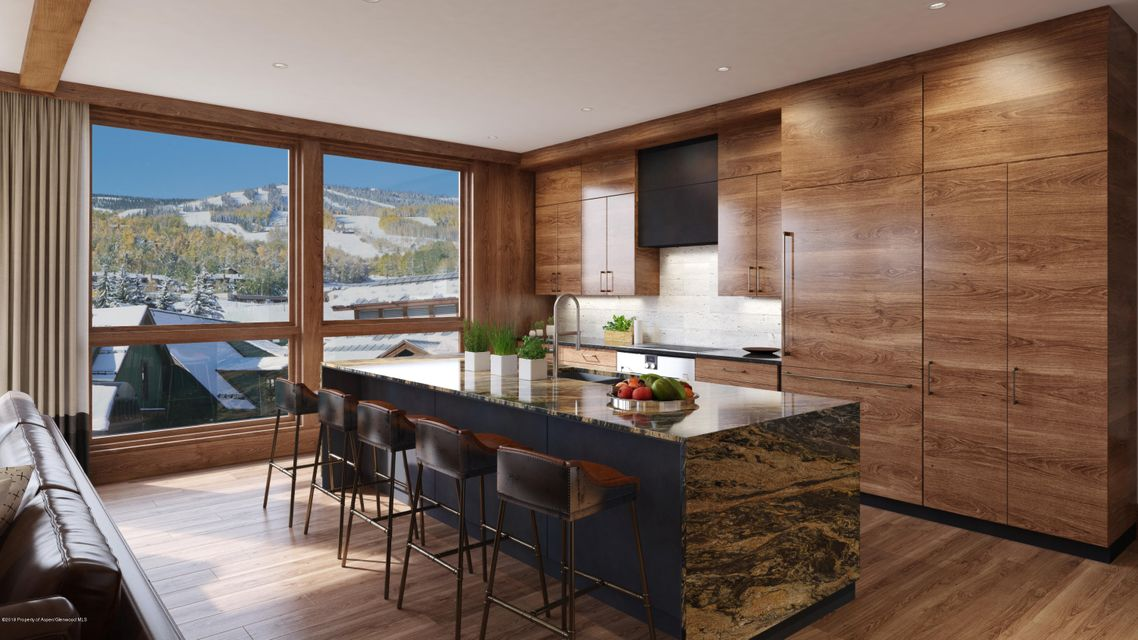 LUMIN - Snowmass Spacious four-bedroom and 4.5-bathroom residenceWindow walls running the length of the kitchen and great room showcase the dramatic mountain viewsTwo living areas in great room separated by a doublesided fireplaceCenterpiece kitchen island perfect for entertainingContemporary European appliances by GaggenauLarge dining room table area adjacent to the kitchen with built-in wine buffetMaster bedroom suite with five fixturemaster bathroomLarge master walk-in closet for allof your outdoor clothing storageOutdoor decks off each guest bedroom featuring views of the plaza and ice rinkDirect elevator accessEntryway with bench seating and storageSteps from plaza and Elk Camp Gondola