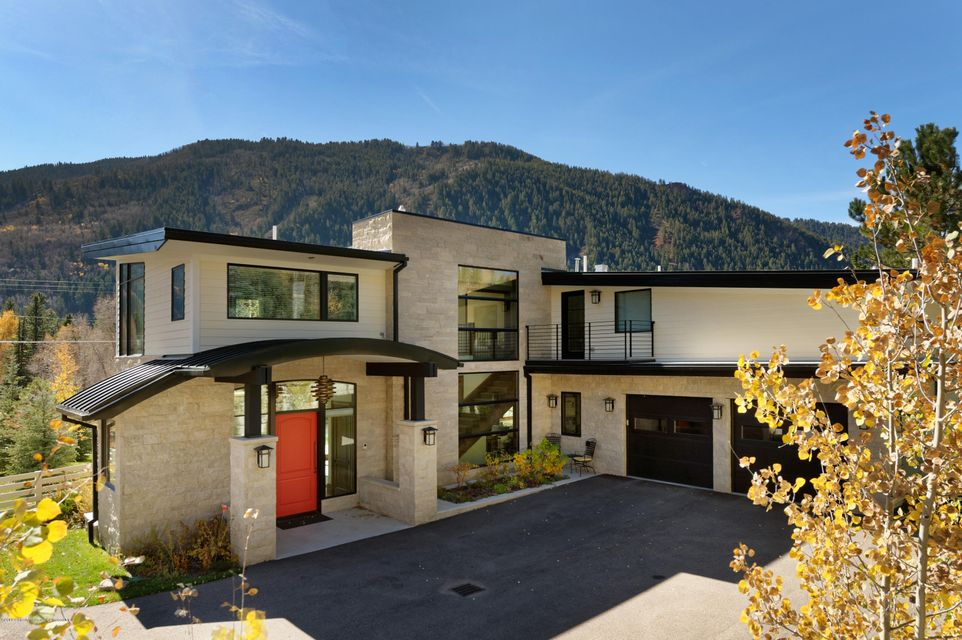 Great memories are ready to be made in this gorgeous, contemporary home less than 1 mile east of Aspen Mountain. Wonderful open floor plan with great views, sunny exposure and fun outdoor space. The large gourmet kitchen, formal and casual dining and comfortable living room are brought together seamlessly by the pass-through fireplace. Walk or bike into town from this convenient location on the bike path or hop on the free shuttle.