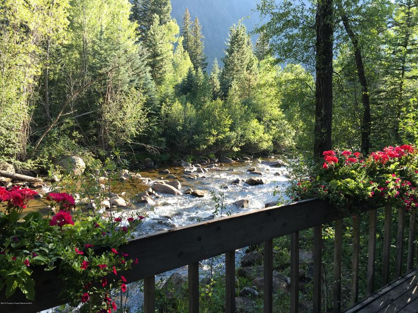 This is the premier lot on the Roaring Fork River in Aspen! The home has approximately 1300 square feet of decks at the river's edge, which cannot be replicated today based on the current code. With a private entrance, mature landscaping and the ability to add FAR, this home has many possibilities. The property has unprecedented views of Aspen Mountain, the Stillwater Open Space, and the White River National Forest. With proximity to both downtown Aspen, as well as numerous hiking and biking trails, this home is a must see. The lot was handpicked by the President of the Aspen Institute to build his own home in the 1970's.