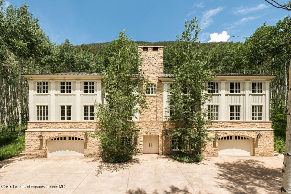 A jewel of classical architecture by world renowned architect, Allan Greenberg with interiors by style-maker Carolyne Roehm.  Evoking a modern Swedish hunting lodge the home is just right for the sophisticated buyer who wants nature in the Rockies.Nestled in the upper Castle Creek Valley, the home is unique, elegant, cozy and constructed with the finest finishes and appointments. Its 76 windows overlook 7 acres of aspen forest. Rich wide-plank oak flooring throughout. The great-room has a 20' coffered ceiling w/intricate crown moldings and a large log-burning fireplace place. A charming wood paneled library; a candle-lit dining room with faux painted floor; cook's kitchen w/butler's pantry; a private master wing; +3 generous guest bedrooms; 2 garages; extensive storage/crawl