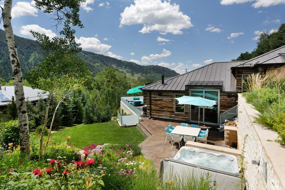 This 6-bedroom contemporary home in East Aspen is sophisticated in style with beautiful interior design, great volume & open floorplan with master suite on living level. Premier location at the end of the cul-de-sac offering amazing views of Aspen Mountain & Independence Pass. Built in 2014 & shows like new. Fabulous for entertaining; spacious kitchen, large snowmelted decks, professional barbeque area, hot tub & extensive landscaping for privacy. 5 bedrooms + media room/flexible 6th bedroom with full bath & closet. Radiant heat, central a/c on main level, wine cellar, solar hot water system, full Crestron system for lighting, shades, entertainment systems & security. Gorgeous master suite with views & spacious, private guest master. Easy walk to town or use Dial A Ride service.