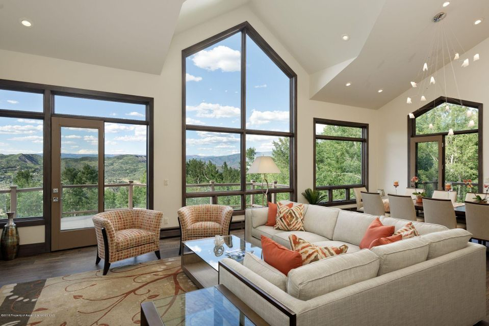This magnificent Snowmass Village residence has just undergone a compete remodel this Spring, 2018! The fully-transformed, eye-catching home boasts designer features throughout; including a grand entry overlooking the great room, dramatic staircase, high vaulted ceilings and a dry stack stone fireplace. Scenes of the mountain valley below are showcased through generously-placed, floor-to-ceiling windows and an irresistible walk-out deck. The spacious chef's kitchen and breakfast nook, also with high ceilings, offer even more space to entertain in a floor plan with timeless design.The home site provides natural, mature landscaping; protecting the quiet mountain setting.See supplement for additional details. Not only is the home and homesite remarkable but is exceptionally convenient, with paved access to Snowmass Village just minutes away for your skiing, shopping and restaurants enjoyment.     This remarkable property features a main floor master suite with easy access to the kitchen and great room on the same level.  Additional three guest suites, including a private secondary master occupy the garden level, which features large windows throughout. This lower floor has additional living space in a family room, featuring the home's second dry stack stone fireplace providing elegance and luxury with a touch of coziness. All four of the homes bedrooms are air-conditioned for peak comfort.  The property, located just off Ridge Road, has a shared driveway. During the winter season, the convenient dial-a-ride service can be utilized for transportation to and from the Village during daytime and evening hours.