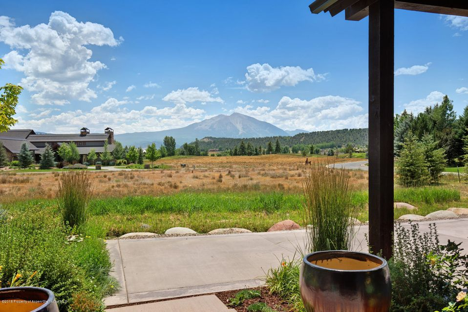 Nicely sited on a corner, this easy living townhome features gorgeous views of Mount Sopris out the front door and great room. The easily accessed first floor master suite has covered patio access. The centerpiece of the light and bright kitchen is a generous island with distinguishing hood and has both a dining area and a smaller eat in breakfast nook. Two guest bedrooms with en suite bathrooms and a stairway landing reading/office nook area complete the second level. Welcome to the playground and comfortable year round living that is Aspen Glen. Walk to private Gold Medal fly fishing on the Roaring Fork River; play golf on the 18-hole Nicklaus-designed course; enjoy world class skiing just 30 minutes away. Club membership available. Being sold furnished.