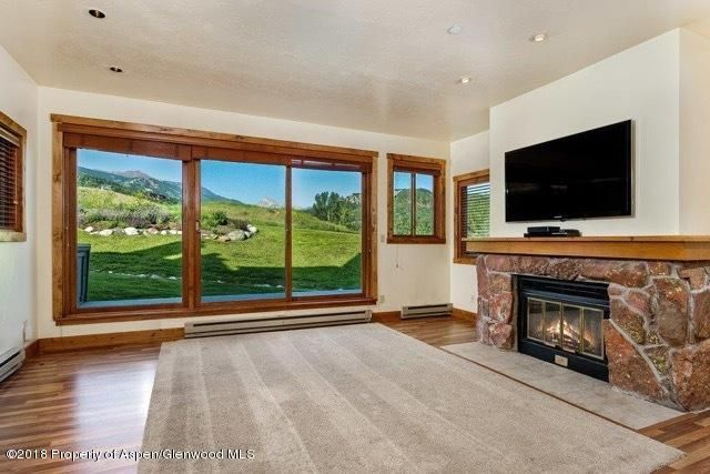 Beautifully renovated 3 bedroom/3 bath with direct views of Mt. Daly. Cherry cabinetry, plastered walls, Corian countertops, with knotty alder solid core doors, base, case and window trim. Upgraded bathrooms with new tile, wood blinds throughout, enhanced lighting, luxury vinyl flooring. Immaculate condition. Move in ready. A one of a kind opportunity. Located on the golf course, across the street from the Snowmass Club, with golf, tennis, pools, gym and spa.
