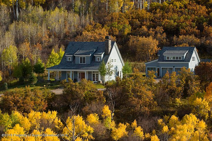 Incredible views are just the beginning! This private cottage in the woods, located at the foot of Mount Sopris, sits on 49+ acres and is surrounded by over 2,000 acres of Colorado's National Forest and public lands. A private and serene setting with panoramic mountain vistas and valley views. The charming 3,400 sf home features a stainless, gourmet kitchen with soapstone counters and mahogany and slate floors. French doors walk out to a patio with running pond. Watch deer and elk wander through the yard from your kitchen window! Amenities available: horse boarding, hiking, cross country skiing and snowshoeing trails as well as guest accommodations at Ranch house.