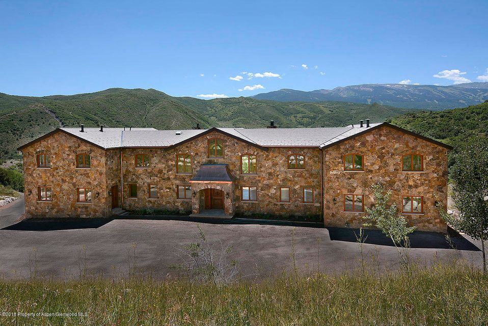 Elegant 14,688 square foot home on 46 private acres minutes from world class skiing, shopping and dining. 10 minutes from Aspen or Snowmass' skiing, Its main rooms capture the quiet beauty of the Rocky Mountains in every window. Many generous rooms for large scale entertaining. Grand salon with carved fireplace, large kitchen, butler's pantry to serve the dining room which can seat two or thirty-two. Main floor office, guest master and soundproofed theatre. Handcrafted antique mahogany entry doors. 2400 square foot Main Master suite with steam shower, large dressing room, two balconies with mountain views. Geothermal heating and cooling, mature trees, senior irrigation water rights, seasonal barn allowed,additional 3 BR caretaker/guest house.