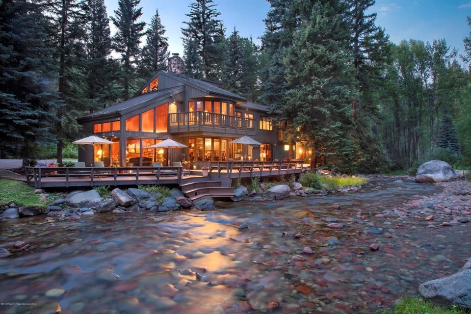 Land, water and legacy describe this 11.3 acre riverfront property adjacent to the city of Aspen that has been in the same ownership for the last 60 years. This represents a true connection to the river with the 4,333 square foot, 6 bedroom house and guest house literally on the water's edge and impossible to recreate today. Just as important is the private bridge that takes you over Castle Creek to a park-like setting with vast lawn areas, fire pit and a trail to S. 7th Street. This rare opportunity to engage with nature is less than a mile from Aspen.