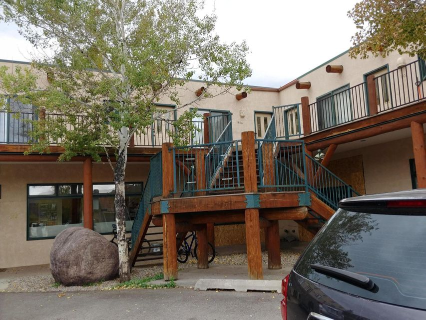 Great location close to downtown! Three bedrooms, two baths. Large back deck. Unit is all on one level but there are outside stairs to reach the unit.Storage room on first level of building.