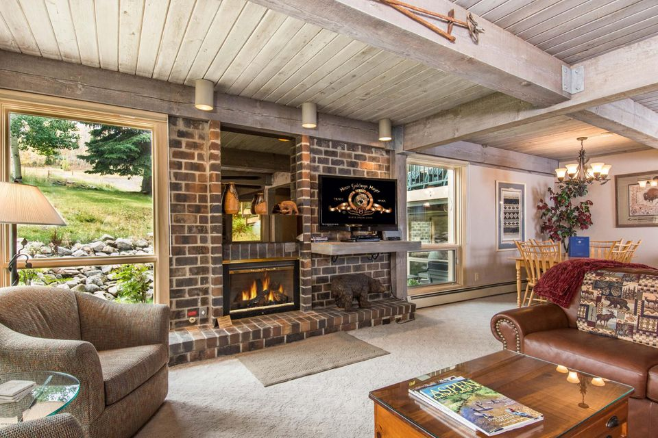The perfect ski retreat with direct ski in/out to Snowmass Mountain and elevator access to your front door with no stairs! Great views of the ski slope!  This two bedroom, two bath has a great mountain feel and remodeled kitchen and baths. Located on the ground floor so you can ski right to your door step! Warm and cozy decor. Gather around the fireplace and enjoy the mountains! The Top of the Village offers superior management, swimming pool, two hot tubs, workout facilities, covered parking, courtesy van throughout the Village and to Aspen Airport. Excellent rental property! This is the best two bedroom offer at Top of the Village - don't miss it!