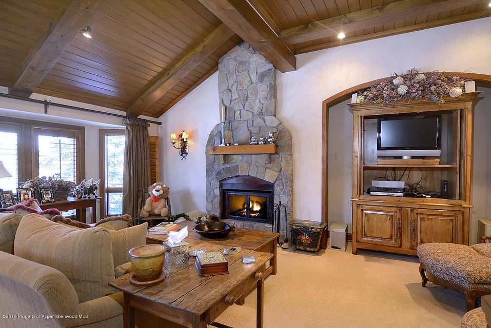 Best ski access in Snowmass Village for a 4 bedroom townhome. Located on the front row of the Woodrun V complex with Fanny Hill literally out the back door, Two bedrooms on top level, and two more on lower level plus a separate living area. Large kitchen, dining, living and office space on the main level. There are storage closets for owners and large closets for rental guests too.Spacious Woodrun V #3 has unobstructed views now and forever. The Master has a private deck to soak in the views and sun year round. Complex has valet parking, on-site rental and property management, year-round hot tub and pool next to the arrival center. Easy to ski in for lunch and walk to apres!